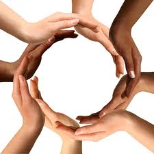 A circle created from hands of people of different races. The picture symbolizes cooperation and equality.